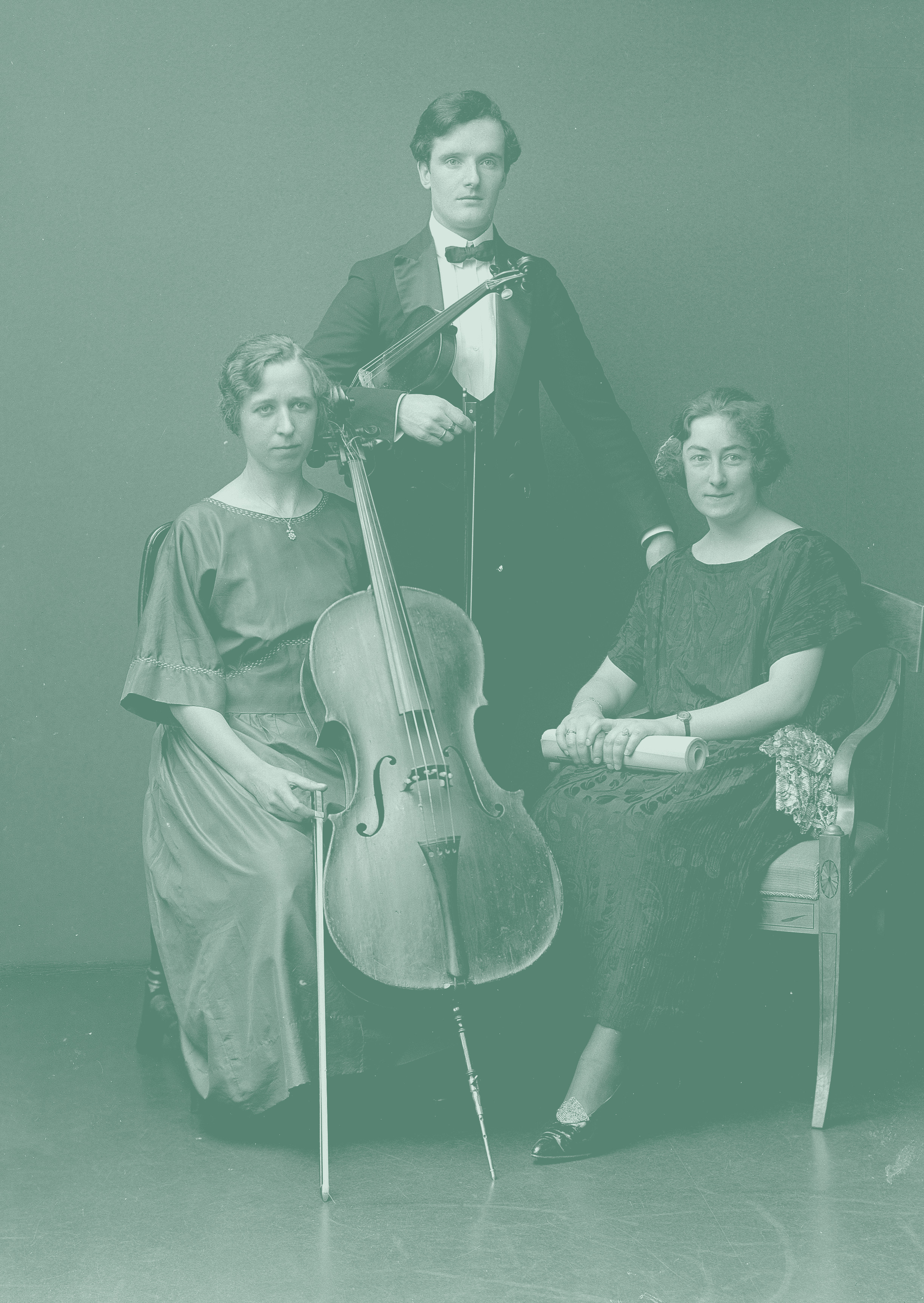 Portrait of three welldressed persons where two poses with string instruments-img